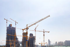 The construction of high-rise buildings. And sky stock images