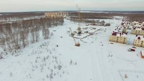 Construction of high-rise buildings in the winter. Aerial view stock video footage