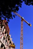 Construction of a high-rise comfortable residential building with a tower crane. Construction of structures-architectural,. Organizational, survey, design stock photography