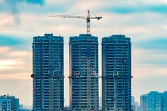 Construction of high-rise residential buildings in the big city. Winter cityscape at sunset. Moscow, Russia royalty free stock images