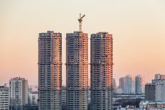 Construction of high-rise residential buildings in the big city. Winter cityscape at sunset. Moscow, Russia royalty free stock photo