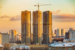 Construction of high-rise residential buildings in the big city. Winter cityscape at sunset . Moscow, Russia.  royalty free stock photography