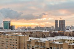 Construction of high-rise residential buildings in the big city. Winter cityscape at sunset. Moscow, Russia royalty free stock photography
