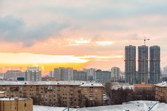 Construction of high-rise residential buildings in the big city. Winter cityscape at sunset. Moscow, Russia stock image