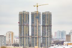Construction of high-rise residential buildings in the big city. Winter cloudy day. Urban landscape.  royalty free stock image