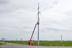 Construction of a high-voltage power line. Assembly and installation of new support of a power line royalty free stock image