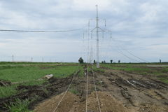 Construction of a high-voltage power line. Royalty Free Stock Images