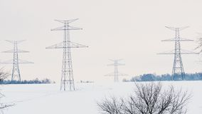 Construction of high voltage pylons in winter. Assembled power transmission line supports. Ready for installation stock video