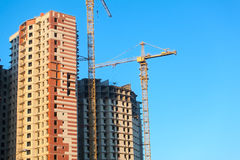 Construction of Highrise buildings with cranes Stock Images