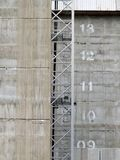 Construction hoist on a modern concrete highrise developent site. With floor numbers marked in stencil paint Stock Image