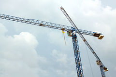 Construction hoisting tower cranes Stock Images