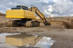 Construction of a hole with excavators to build houses stock image