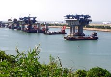 Construction of Hong Kong-Zhuhai-Macao Bridge. The Hong Kong–Zhuhai–Macau Bridge HZMB is an ongoing construction project which consists of a series of Stock Photos