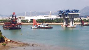 Construction of Hong Kong-Zhuhai-Macao Bridge. The Hong Kong–Zhuhai–Macau Bridge HZMB is an ongoing construction project which consists of a series of Stock Photography