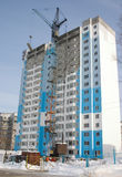 Construction of house. Construction of a multi-storey apartment house. A typical building of an average strip of Russia Royalty Free Stock Photo