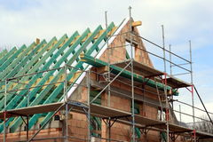 Rough construction of a family house. Construction of a house. Creation of the roof Stock Image