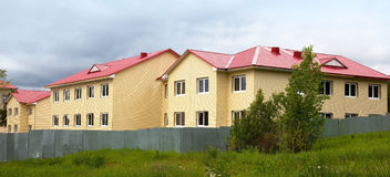 Construction of the house. Finishing work. Facade. Royalty Free Stock Images