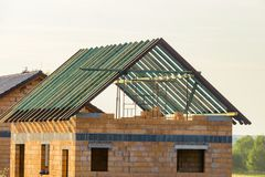 Construction of a house made of bricks, roof repair, new building royalty free stock photo