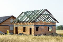 Construction of a house made of bricks, roof repair, new building royalty free stock image
