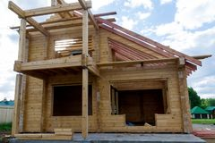 Construction of a house made of laminated veneer lumber. The frame of the house. Cottage made of laminated wood stock photo