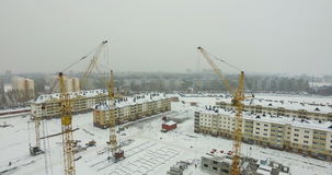 Construction of houses, cranes on site stock video