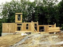 Construction - I've Been Framed!. The framing of a new house has just begun in a new home community in Northern Kentucky, USA. The exterior walls are going up royalty free stock photo