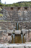 Construction of the Incas in Peru. Waterfall ending source, a construction of the Incas in Peru Stock Photos