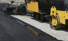 Construction. Industrial pavement truck laying asphalt on construction site Royalty Free Stock Image
