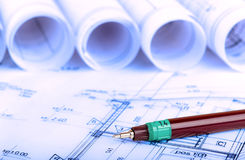 Construction industry Architecture rolls architectural plans project architect blueprints real estate Royalty Free Stock Photo