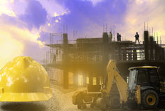 Construction industry building on high ground with yellow helmet Royalty Free Stock Photography