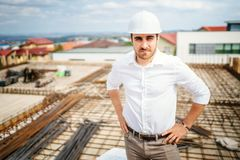 Construction industry business man, apartment buildings developer. Portrait of construction industry business man, apartment buildings developer stock image
