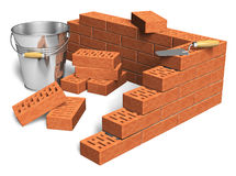 Construction industry concept. Fragment of red brick wall, heap of bricks, trowel and metal bucket isolated on white background Royalty Free Stock Images