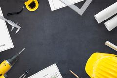 Construction industry concept. Projects and tools on work desk with free space for text stock photo