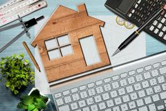 Construction Industry Concept - Wooden House Model Stock Images