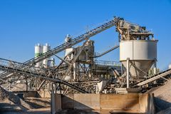 Construction industry concrete plant. Structure on a clear blue sky stock photography