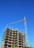 Construction industry with Crane, Copy Space, Sky Background. Crane Building New House on the Construction Site. Royalty Free Stock Photo