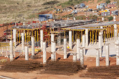 Construction Industry Floor Columns. Buiding construction site first floor basement concrete steel columns and floor supports structure steel materials for new Royalty Free Stock Photos