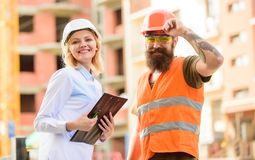 Construction industry. Foreman established supply of building materials. Expert and builder communicate about supply. Building materials. Successful deal royalty free stock images