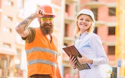 Construction industry. Foreman established supply of building materials. Expert and builder communicate about supply. Building materials. Successful deal stock image