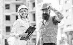 Construction industry. Foreman established supply of building materials. Expert and builder communicate about supply. Building materials. Successful deal royalty free stock photo