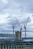Construction industry over the London skyline. High rise tower b Stock Photos