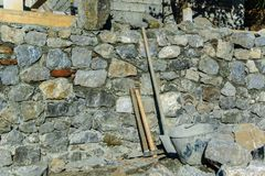 Construction industry - Stone wall construction and masonry tools. Stone wall construction and masonry tools. Copy space Stock Photography
