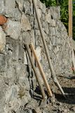 Construction industry - Stone wall construction and masonry tools. Stone wall construction and masonry tools. Copy space Royalty Free Stock Photography