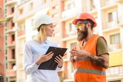Construction industry. Successful deal concept. Foreman established supply of building materials. Expert and builder. Communicate about supply building stock photos
