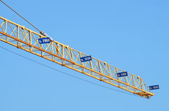 Construction industry tower crane against clear blue sky Stock Image