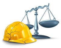 Construction Injury Law. And work accident and health hazards on the job as a broken cracked yellow hardhat helmet and a scale of justice in a legal concept of Stock Photo