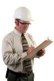 Construction Inspector 4. A construction safety inspector with safety goggles and a hard hat inspecting a jobsite Stock Photo