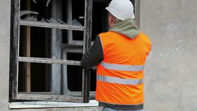 Construction inspector with cell phone near building stock video