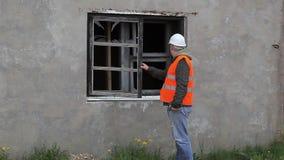 Construction inspector check broken window stock video footage