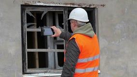 Construction inspector filmed broken window stock footage